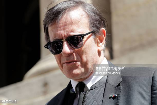 French actor Francis Huster leaves the SaintRoch Church in Paris after attending the funeral of French actor JeanMarc Thibault on June 12 2017 / AFP...
