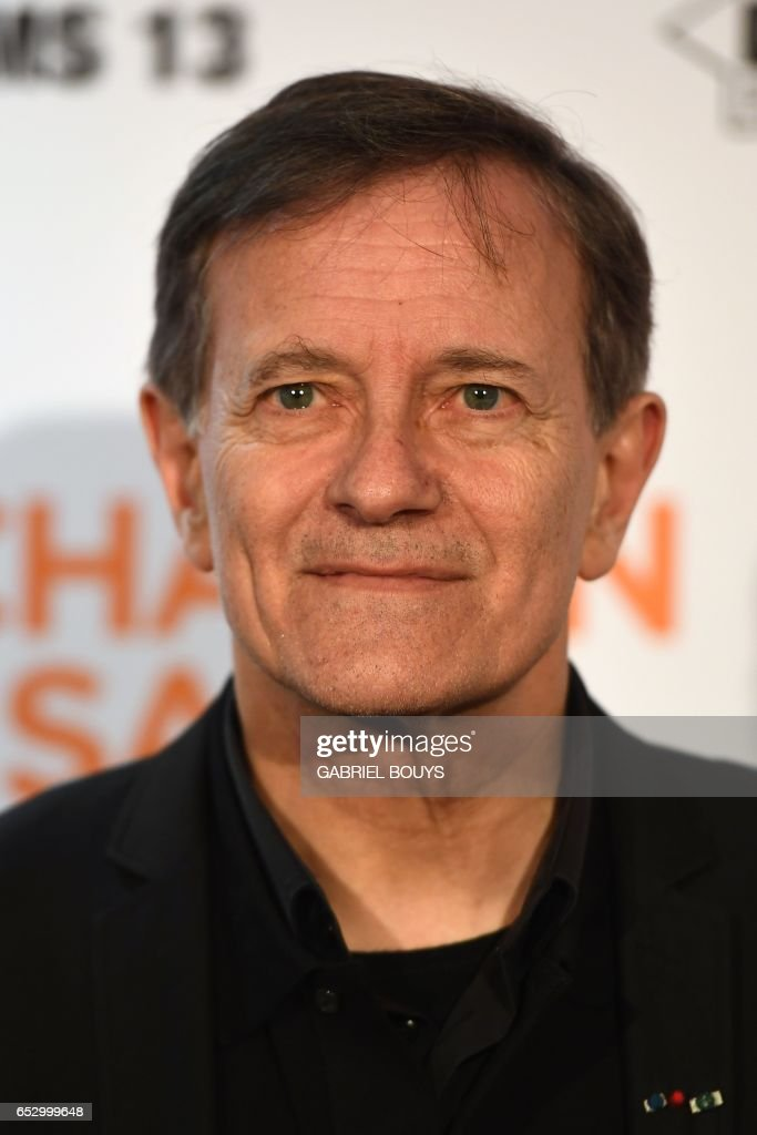 French actor Francis Huster poses during the photocall for the premiere of the film 'Chacun Sa Vie' in Paris on March 13, 2017. The film is directed by French director Claude Lelouch. /