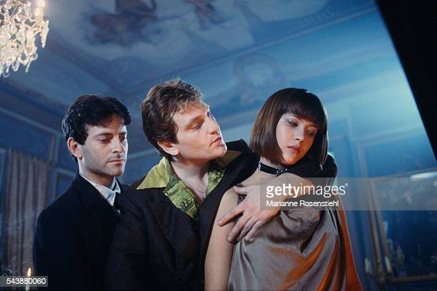 French actor Francis Huster Turkishborn French actor Tcheky Karyo and French actress Sophie Marceau on the set of L'Amour Braque by her husband...