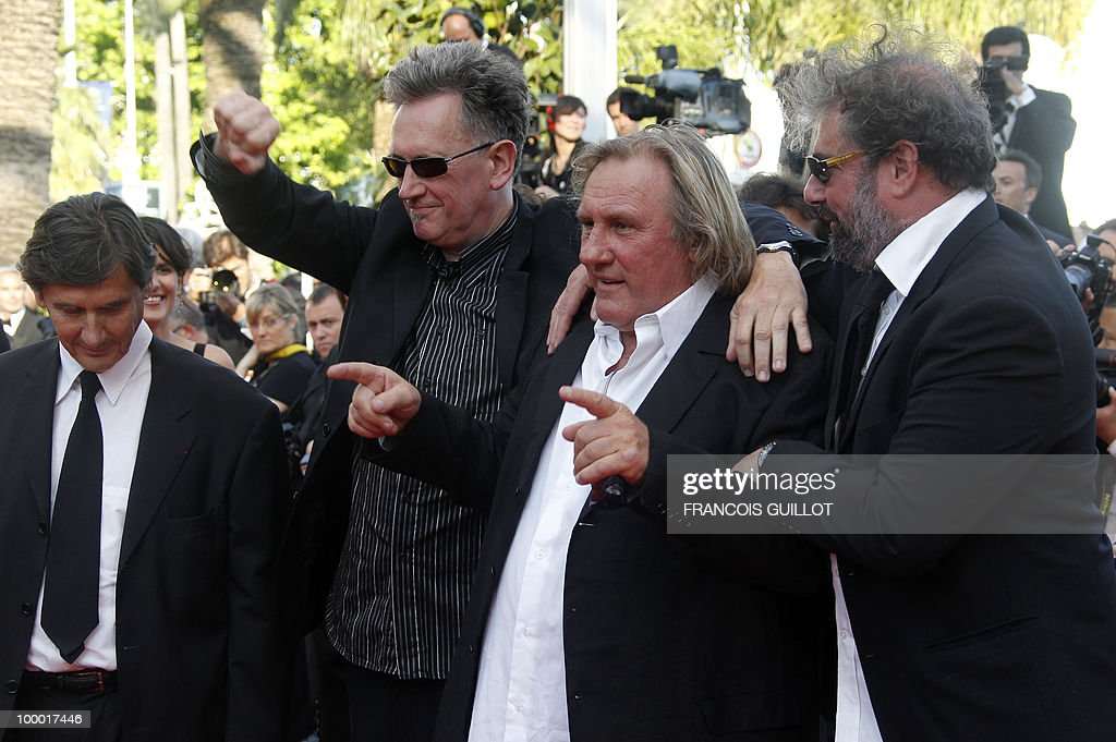 French actor Gerard Depardieu (2ndR), actor and director Benoit Delepine (2ndL) and actor Gustave Kervern (R) arrive for the screening of 'Fair Game' presented in competition at the 63rd Cannes Film Festival on May 20, 2010 in Cannes.