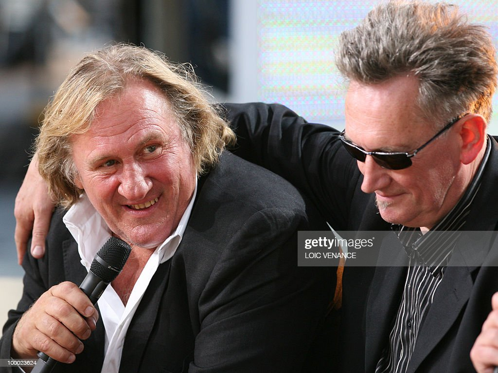 French actor Gerard Depardieu and director Benoit Delepine attend the Canal+ TV show 'Le Grand Journal' during the 63rd Cannes Film Festival on May 20, 2010 in Cannes.