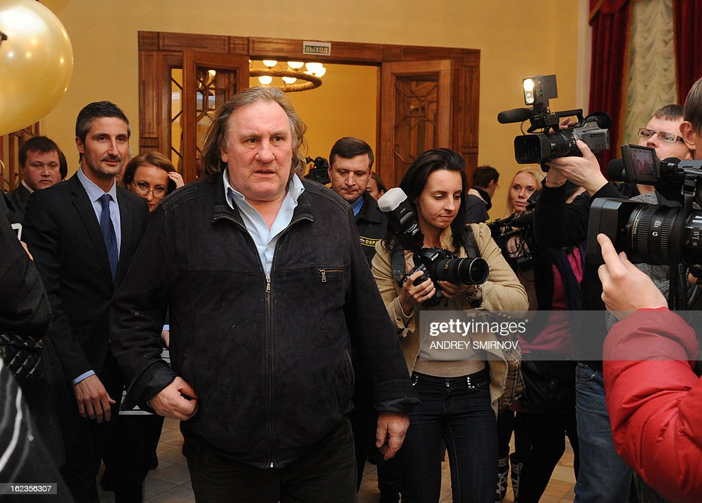 French actor Gerard Depardieu arrives in Illusion Cinema in Moscow on February 22, 2013, to attend the opening of the newly restored cinema. Depardieu, who was granted a Russian passport by President Vladimir Putin after complaining at high tax rates in France, was set to spend today in Moscow before travelling 650 kilometres (400 miles) to the provincial city of Saransk to register as a resident of No. 1 Democracy Street (Demokraticheskaya Ulitsa).