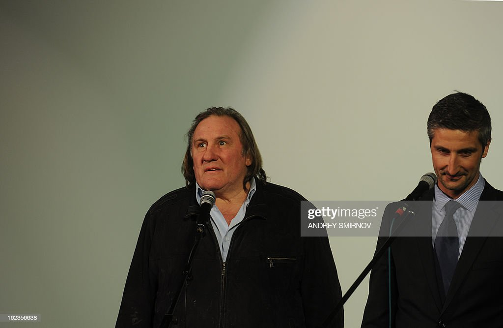 French actor Gerard Depardieu attends the opening of the newly restored Illusion Cinema in Moscow on February 22, 2013. Depardieu, who was granted a Russian passport by President Vladimir Putin after complaining at high tax rates in France, was set to spend today in Moscow before travelling 650 kilometres (400 miles) to the provincial city of Saransk to register as a resident of No. 1 Democracy Street (Demokraticheskaya Ulitsa).