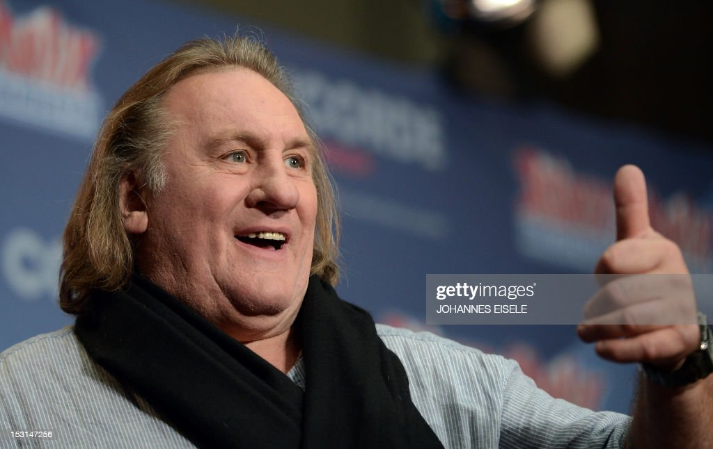 French actor Gerard Depardieu gestures during a photocall for the new Asterix film 'Au service de Sa Majesté' (God Save Britannia) on October 1, 2012 in Berlin. The film also staring French actress Catherine Deneuve is set to open on October 18, 2012 in the German cinemas.