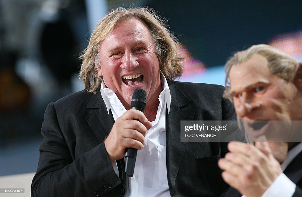 French actor Gerard Depardieu laughs next to his puppet as he attends the Canal+ TV show 'Le Grand Journal' during the 63rd Cannes Film Festival on May 20, 2010 in Cannes.