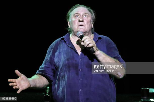 French actor Gerard Depardieu performs on stage during a 'Depardieu chante Barbara' concert at the Opera Garnier in Monaco on July 27 2017 / AFP...