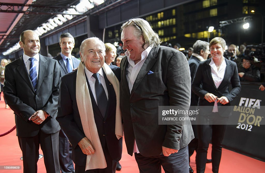 French actor Gerard Depardieu (R) shares a joke with FIFA President Joseph Blatter as they arrive for the FIFA Ballon d'Or awards ceremony at the Kongresshaus in Zurich on January 7, 2013. AFP PHOTO / FABRICE COFFRINI