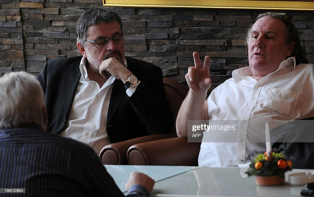 French actor Gerard Depardieu (R) talks with Montenegro Minister of Culture Branislav Micunovic (L) in the luxurious Hotel Splendid, near Budva on the Adriatic coast of Montenegro on January 8, 2013. Depardieu spurned a Paris drunk driving court appearance and instead went to Montenegro to prepare a film in which the larger-than-life French star will play Dominique Strauss-Kahn.