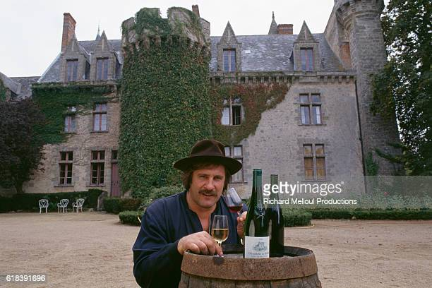 French actor Gerard Depardieu tasting hos own Chateau de Tigne wines from his vineyard | Location Tigne France