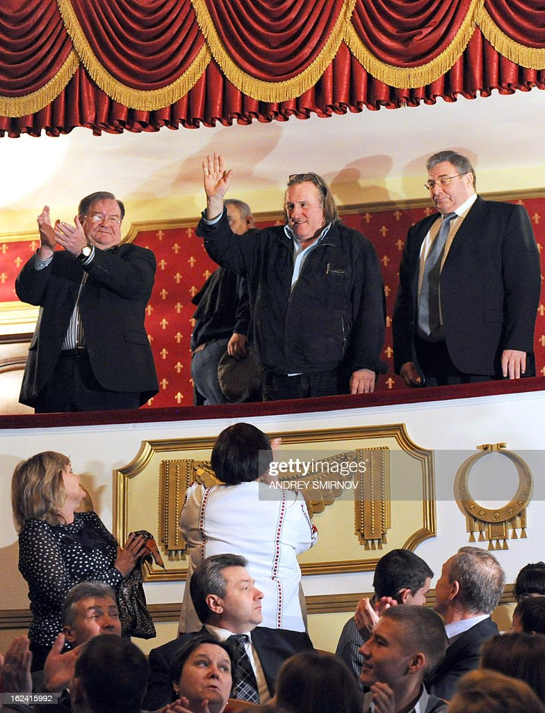 French actor Gerard Depardieu (C) waves at the audience after getting his passport registration at the theatre in Saransk, on February 23, 2013. Depardieu, who was granted a Russian passport by President Vladimir Putin after complaining at high tax rates in France, was set to spend today in Moscow before travelling 650 kilometres (400 miles) to the provincial city of Saransk to register as a resident of No. 1 Democracy Street (Demokraticheskaya Ulitsa).