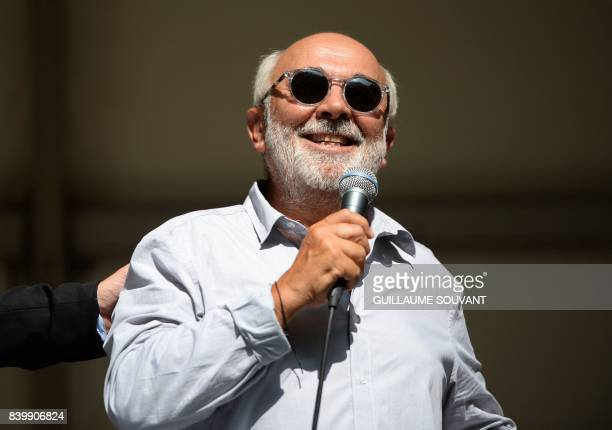 French actor Gerard Jugnot smiles as he gives a speech during the 22th La Foret Des Livres book fair on August 27 2017 in ChanceauxpresLoches central...
