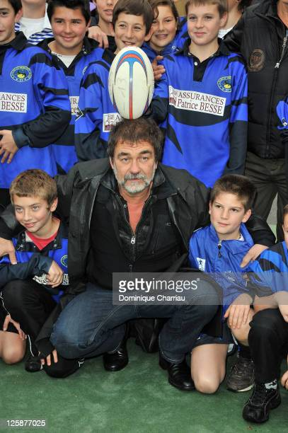 French actor Gerard Lanvin and French Director and actor Olivier Marchal pose with the rugby school of Sarlat during the 19th Festival du Film de...