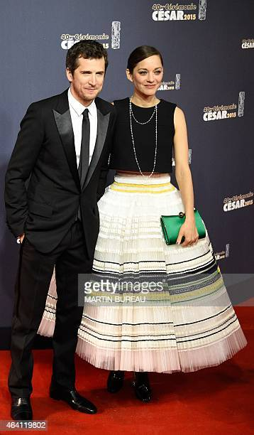 French actor Guillaume Canet and his partner French actress Marion Cotillard pose as they arrive for the 40th edition of the Cesar Awards ceremony on...