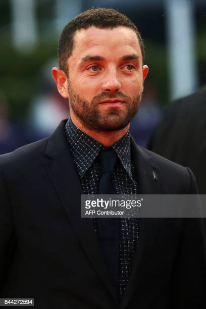 French actor Guillaume Gouix poses on the red carpet before the screening of the movie 'Mother' on September 8 2017 in the northwestern sea resort of...
