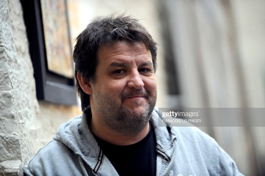 French actor Guy Lecluyse poses on February 26, 2013 in Lille, northern France, after a press presentation of the French movie 'Une chanson pour ma mere'.