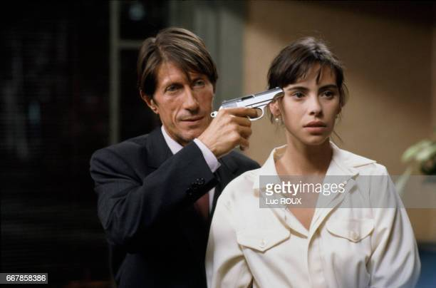 French actor Jacques Dutronc and actress Mathilda May on the set of the film Toutes Peines Confondues directed by Michel Deville