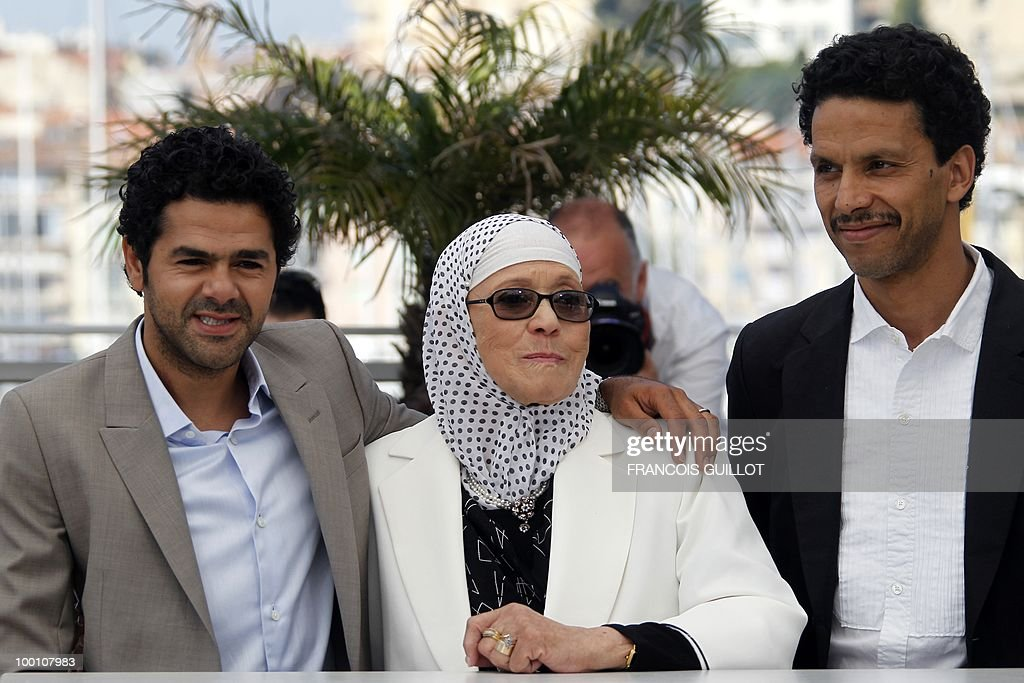 French actor Jamel Debbouze, actress Chafia Boudraa and French actor Roschdy Zem pose during the photocall of 'Hors La Loi' (Outside of the Law) presented in competition at the 63rd Cannes Film Festival on May 21, 2010 in Cannes.