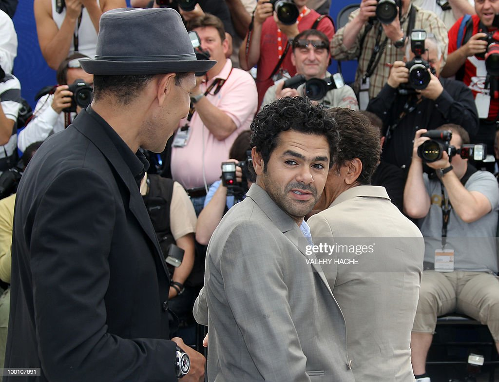 French actor Jamel Debbouze and French actor Roschdy Zem (L) pose during the photocall of 'Hors La Loi' (Outside of the Law) presented in competition at the 63rd Cannes Film Festival on May 21, 2010 in Cannes.