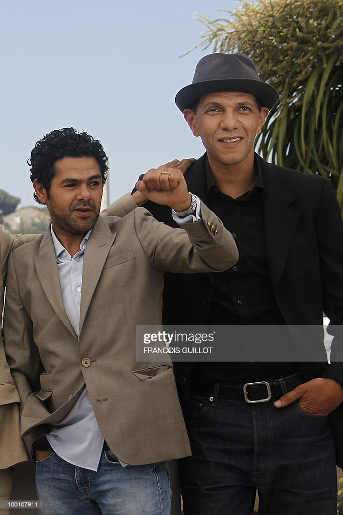 French actor Jamel Debbouze and French actor Roschdy Zem pose during the photocall of 'Hors La Loi' (Outside of the Law) presented in competition at the 63rd Cannes Film Festival on May 21, 2010 in Cannes.