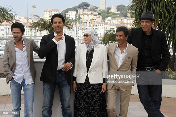 French actor Jamel Debbouze French actor Sami Bouajila actress Chafia Boudraa French director Rachid Bouchareb and French actor Roschdy Zem pose...