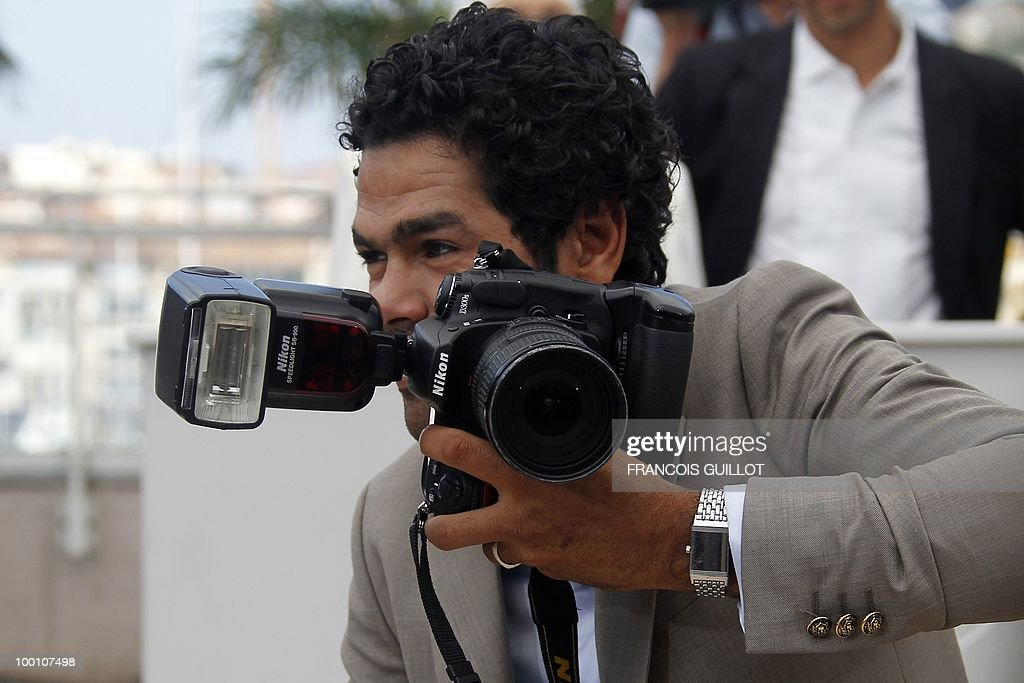 French actor Jamel Debbouze pretends to take picture as he poses during the photocall of 'Hors La Loi' (Outside of the Law) presented in competition at the 63rd Cannes Film Festival on May 21, 2010 in Cannes.