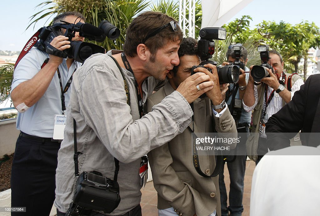 French actor Jamel Debbouze (2ndR) pretends to take picture as he poses during the photocall of 'Hors La Loi' (Outside of the Law) presented in competition at the 63rd Cannes Film Festival on May 21, 2010 in Cannes.