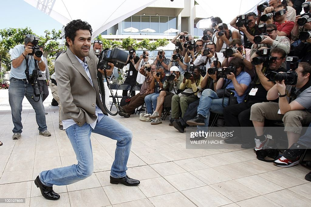 French actor Jamel Debbouze pretends to take pictures as he poses during the photocall of 'Hors La Loi' (Outside of the Law) presented in competition at the 63rd Cannes Film Festival on May 21, 2010 in Cannes.
