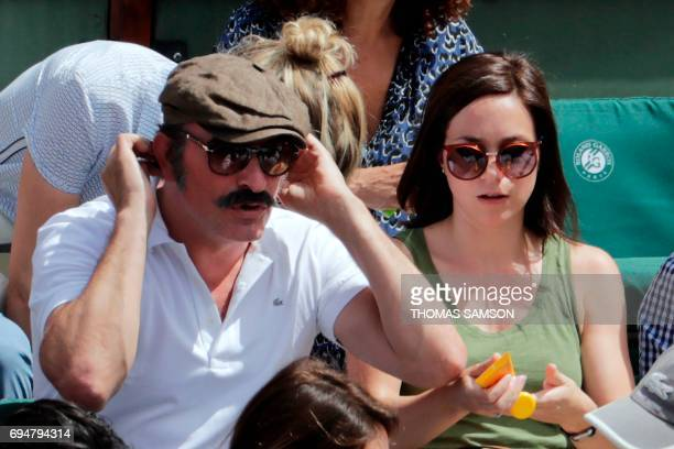 French actor Jean Dujardin and his partner former French figure skater Nathalie Pechalat attend the final tennis match between Spain's Rafael Nadal...