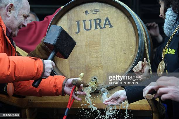 French actor Jean Francois Stevenin broaches a barrel of yellow wine during the traditional event of the 'Percée du vin jaune' in Perrigny on...