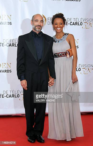 French actor Jean marc Barr and his wife pose during the closing Ceremony of the 52nd MonteCarlo Television Festival on June 14 2012 in Monaco The...