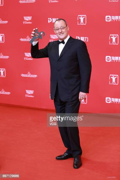 French actor Jean Reno arrives at the red carpet of the 20th Shanghai International Film Festival on June 17 2017 in Shanghai China