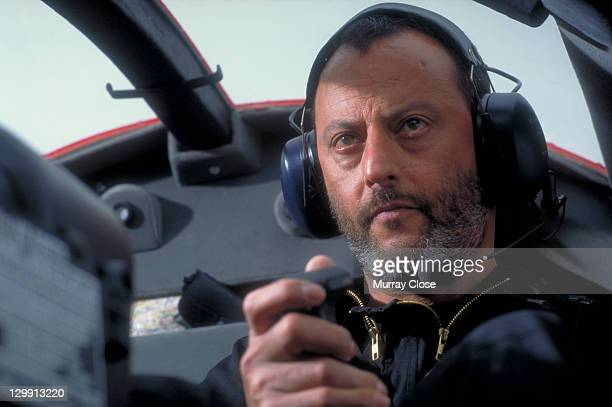 French actor Jean Reno as agent Franz Krieger piloting a helicopter in a scene from the film 'Mission Impossible' 1996