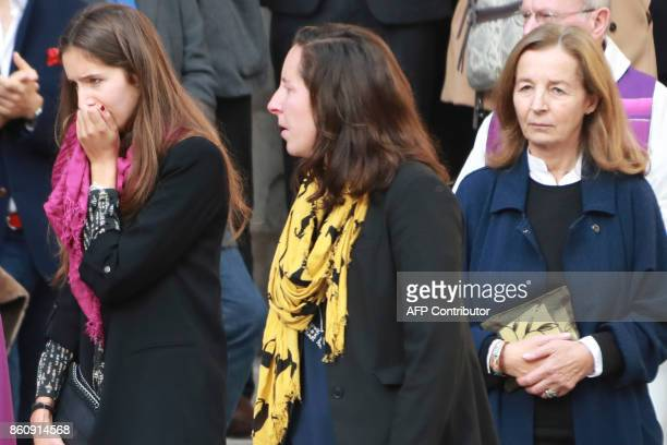 French actor Jean Rochefort's widow Francoise Vidal and two of his daughters Clemence and Louise leave after Rochefort's funeral at the SaintThomas...