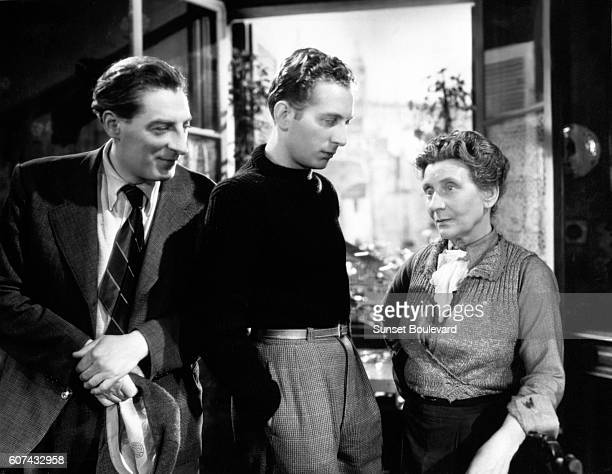 French actor Jean Tissier singer and songwriter Charles Trenet and actress Sylvie on the set of the musical Romance de Paris written and directed by...