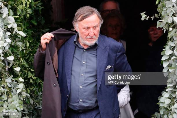 French actor JeanFrancois Balmer leaves after a funeral ceremony for late French actor Claude Rich at the SaintPierre SaintPaul church in Orgeval...