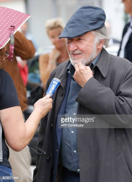 French actor JeanFrancois Balmer speaks to the press after a funeral ceremony for late French actor Claude Rich at the SaintPierre SaintPaul church...