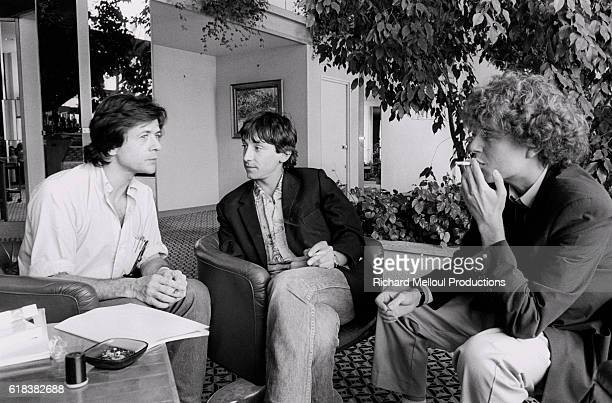 French actor JeanHugues Anglade with screenwriter Hervé Guibert and director and screenwriter Patrice Chéreau attend the 36th Cannes Film Festival to...