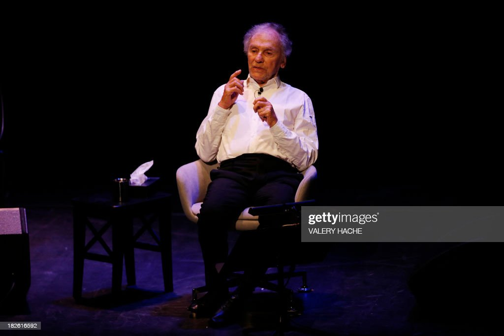French actor Jean-Louis Trintignant performs onstage during a poetic recital on October 1, 2013, at the Anthea theater in Antibes, southeastern France. The 82-year-old Oscar-winning actor is bowing out of a critically-acclaimed career after announcing in an interview published on September 23, 2013 in the French newspaper Nice-Matin that this would be his last performance.