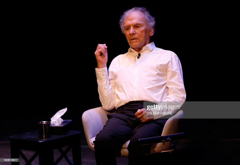 French actor Jean-Louis Trintignant performs onstage during a poetic recital on October 1, 2013, at the Anthea theater in Antibes, southeastern France. The 82-year-old Oscar-winning actor is bowing out of a critically-acclaimed career after announcing in an interview published on September 23, 2013 in the French newspaper Nice-Matin that this would be his last performance. AFP PHOTO / VALERY HACHE