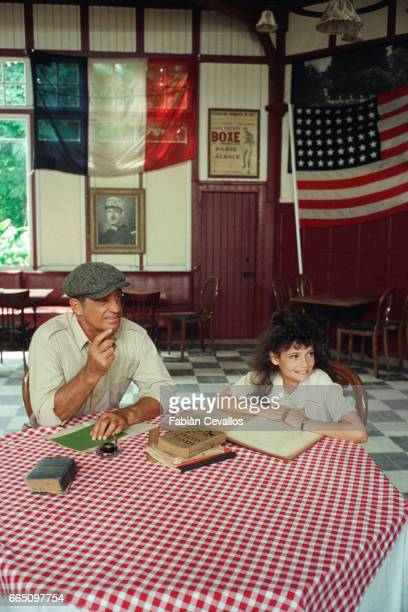 French actor JeanPaul Belmondo and young actress Salome Lelouch on the set of Les Miserables directed by Claude Lelouch and based on Victor Hugo's...