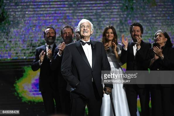 TOPSHOT French actor JeanPaul Belmondo delivers a speech on stage during the 42nd edition of the Cesar Ceremony at the Salle Pleyel in Paris on...