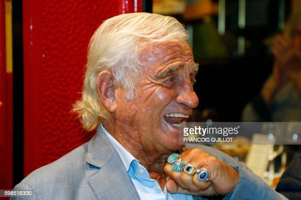 French actor JeanPaul Belmondo gestures after being awarded of the 'Prix du singe' in reference to the movie 'Un Singe en Hiver' and in tribute to...