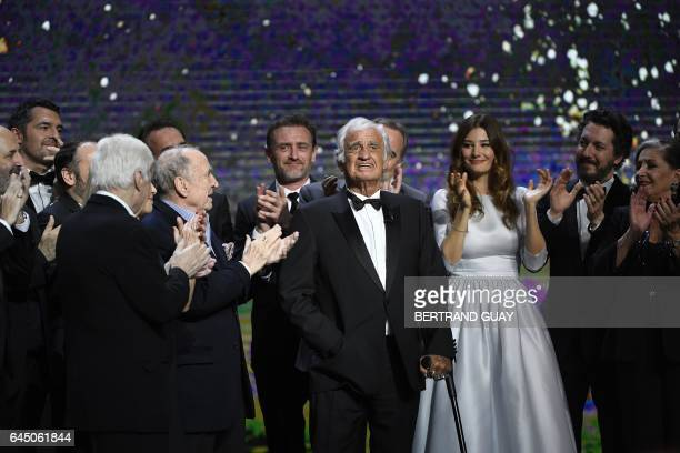 French actor JeanPaul Belmondo is congratulated on stage by actors including French actor Guillaume Gallienne French actress Alice Pol and French...