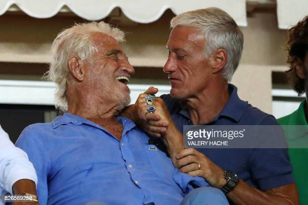French actor JeanPaul Belmondo talks with French national football team's coach Didier Deschamps during the French football match Monaco vs Toulouse...