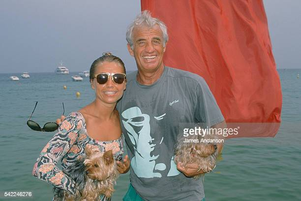 French actor JeanPaul Belmondo with his wife Nathalie 'Natty' and their dogs during their summer holiday in Saint Tropez