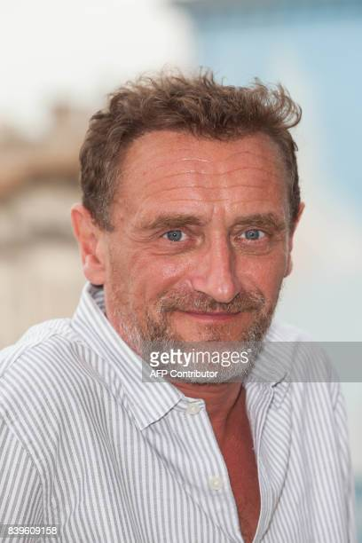 French actor JeanPaul Rouve poses during a photocall for 'Le sens de la fete' movie during the 10th Francophone Angouleme Film Festival on August 26...