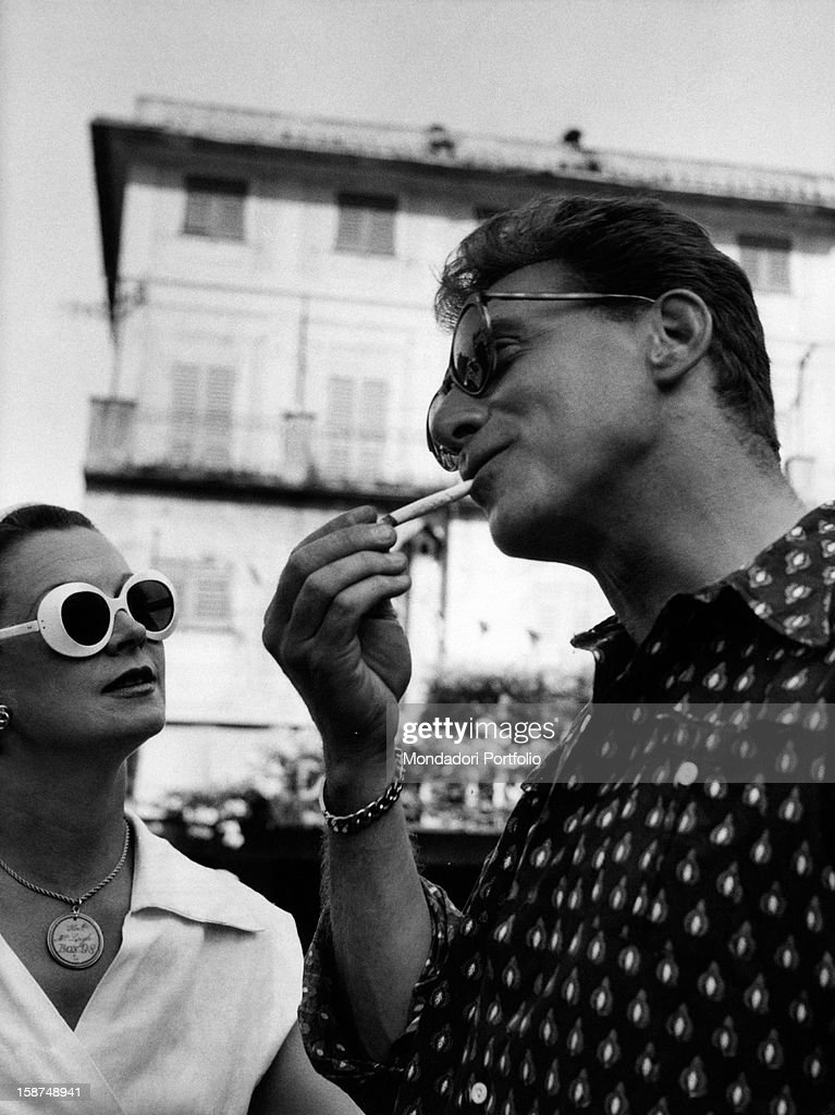 French actor Jean-Pierre Aumont smoking with British actress Vivien Leigh (Vivian Mary Hartley, Lady Olivier). Portofino, 25th July 1954