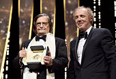 French actor JeanPierre Leaud poses with member of the Jury Arnaud Desplechin after being awarded with the honourary Palme d'Or during the Closing...