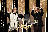 French actor JeanPierre Leaud receives from member of the Jury Arnaud Desplechin the honourary Palme d'Or prize during the Closing Ceremony at the...