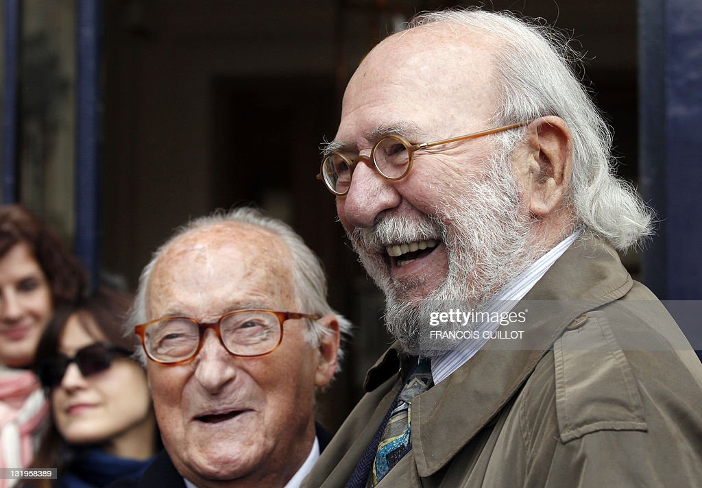 French actor Jean-Pierre Marielle (R) and French historian and Academie Francaise member Alain Decaux attend a ceremony to unveil a plaque to mark the building where French entertainer Henri Salvador had lived for 46 years, 6 place Vendome in Paris, on November 9, 2011.